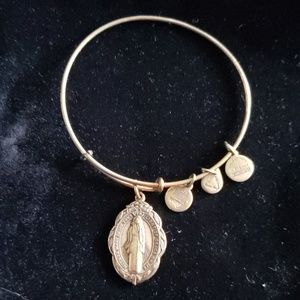 Bronze-tone fashion bangle with religious charm